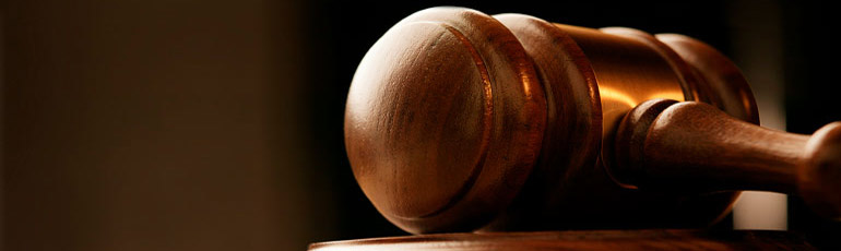 a wooden gavel on a black background